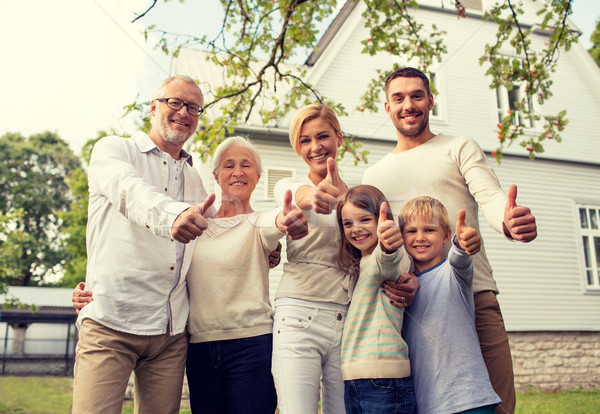 Stock photo: happy family in front of house outdoors
