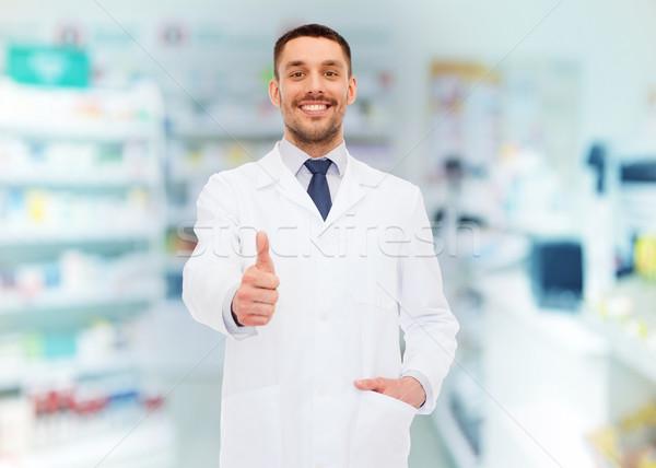 Glimlachend apotheker tonen drogist geneeskunde Stockfoto © dolgachov