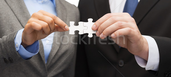 Stock photo: businessman and businesswoman with puzzle pieces