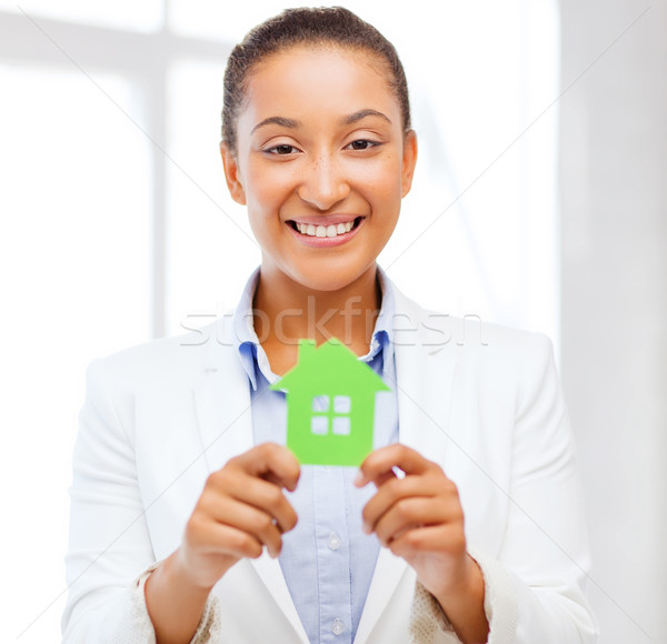 african woman holding green paper house Stock photo © dolgachov