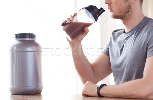 close up of man drinking protein shake Stock photo © dolgachov