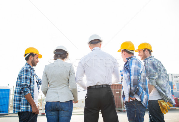 group of builders and architects at building site Stock photo © dolgachov