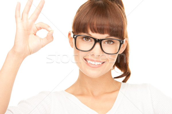 bright picture of lovely woman showing ok sign Stock photo © dolgachov