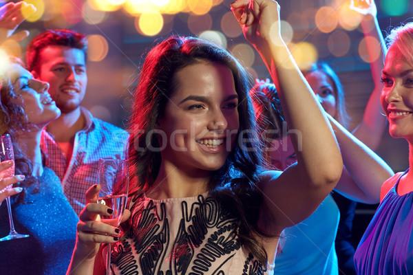 Boldog barátok pezsgő tánc éjszakai klub buli Stock fotó © dolgachov