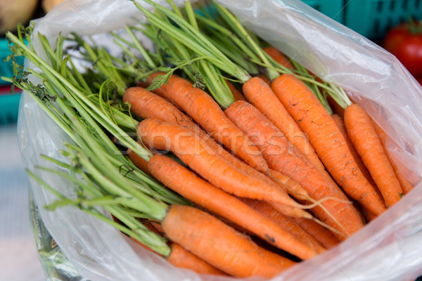 close up of carrot in plastic bag at street market Stock photo © dolgachov