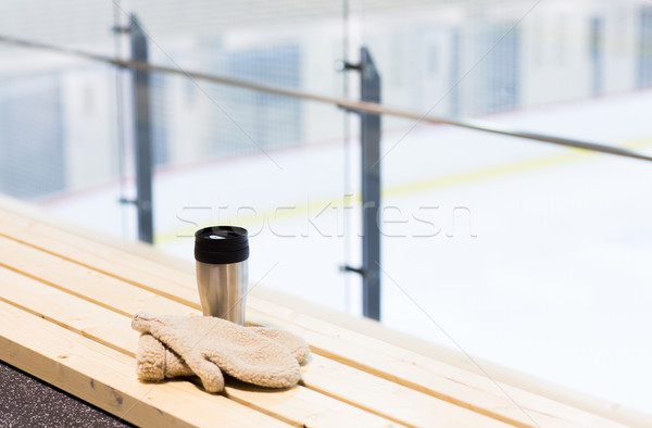 thermos cup and mittens on bench at ice rink arena Stock photo © dolgachov