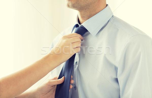 close up of woman hands adjusting tie on mans neck Stock photo © dolgachov
