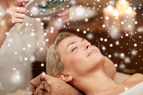 close up of young woman and beautician in spa Stock photo © dolgachov