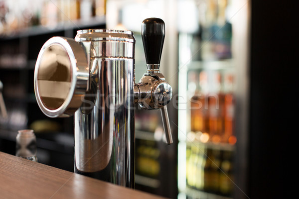 close up of single tap chrome draft beer tower Stock photo © dolgachov
