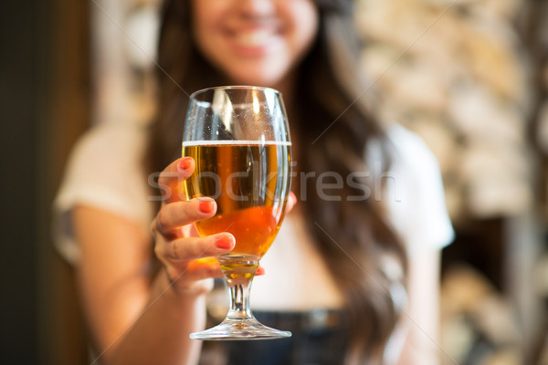 happy woman holding glass of draft lager beer Stock photo © dolgachov