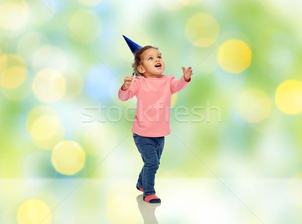 Boldog kicsi kislány születésnapi buli kalap gyermekkor Stock fotó © dolgachov