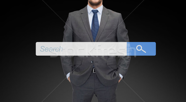 close up of businessman with internet search bar Stock photo © dolgachov