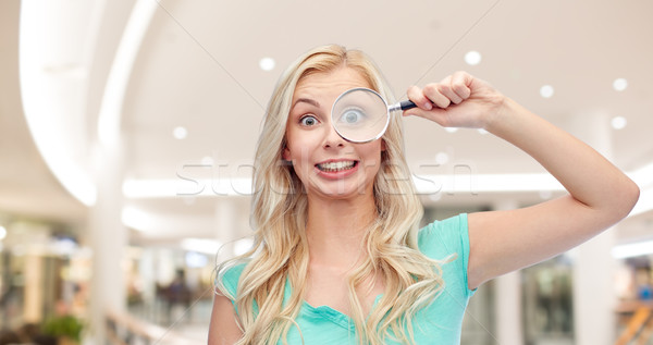 happy young woman with magnifying glass Stock photo © dolgachov