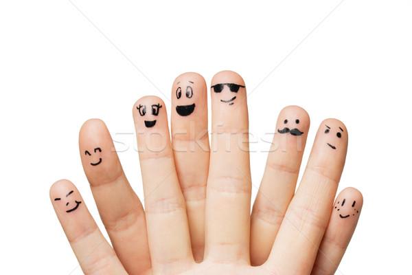 Mani dita facce gesto Foto d'archivio © dolgachov
