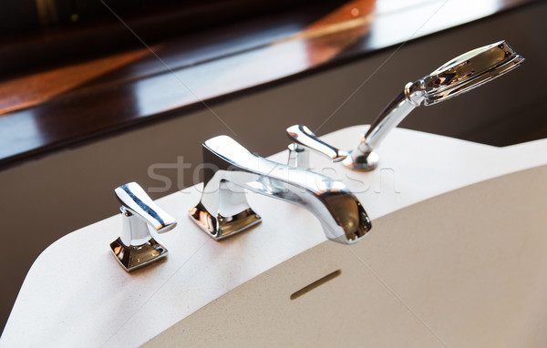 close up of bath tap and shower at bathroom Stock photo © dolgachov