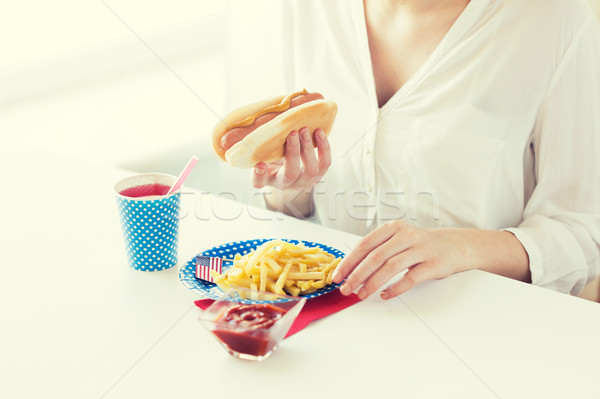 close up of woman eating hotdog and french fries Stock photo © dolgachov