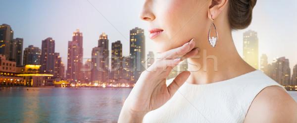 Piękna kobieta twarz kolczyki glamour piękna Zdjęcia stock © dolgachov