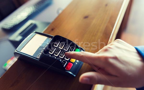 hand entering password to bank terminal Stock photo © dolgachov