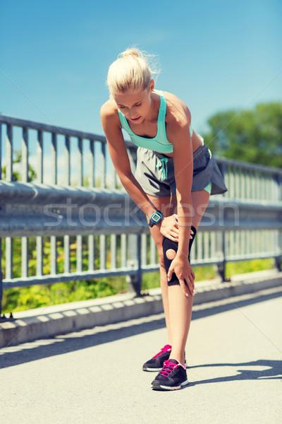 Herido rodilla pierna aire libre fitness Foto stock © dolgachov