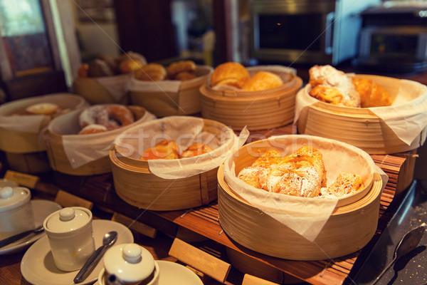 bread and buns at restaurant Stock photo © dolgachov