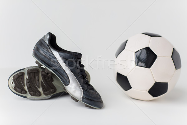 close up of soccer ball and football boots Stock photo © dolgachov
