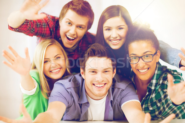 group of students at school Stock photo © dolgachov