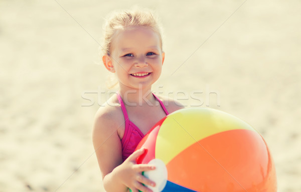happy little girl playing inflatable ball on beach Stock photo © dolgachov