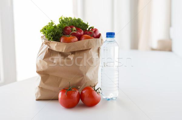 basket of fresh vegetables and water at kitchen Stock photo © dolgachov