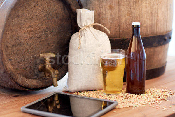 close up of beer barrel, tablet pc and malt Stock photo © dolgachov
