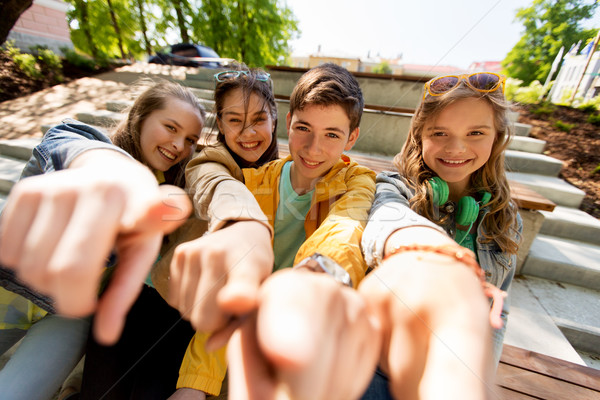 teenage friends or students pointing finger at you Stock photo © dolgachov