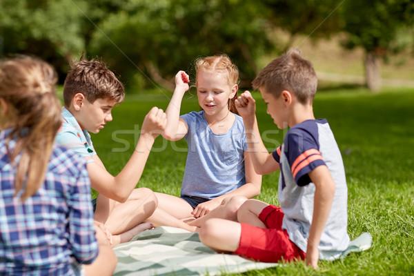 happy kids playing rock-paper-scissors game Stock photo © dolgachov
