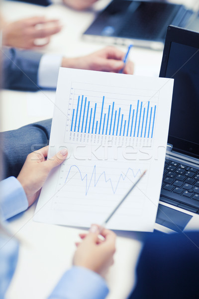 Stock photo: close up of chats, laptop and graphs in office