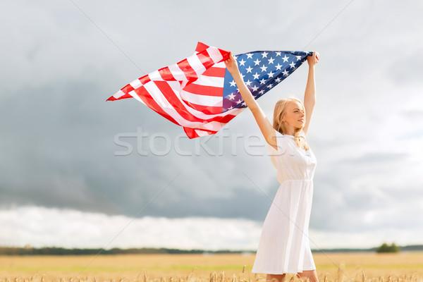 Heureux femme drapeau américain céréales domaine pays Photo stock © dolgachov