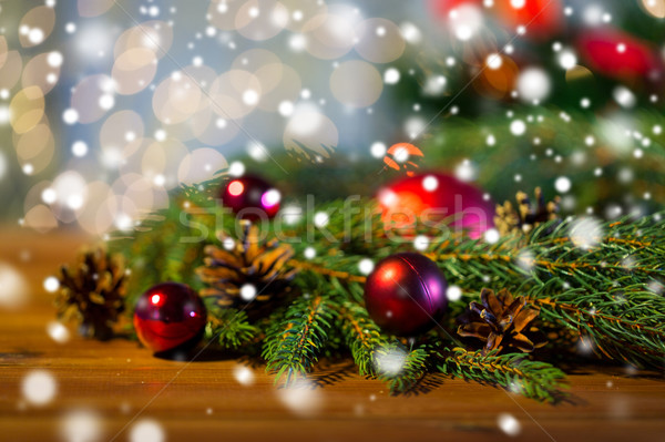 Stock photo: fir branch with christmas ball and pinecones