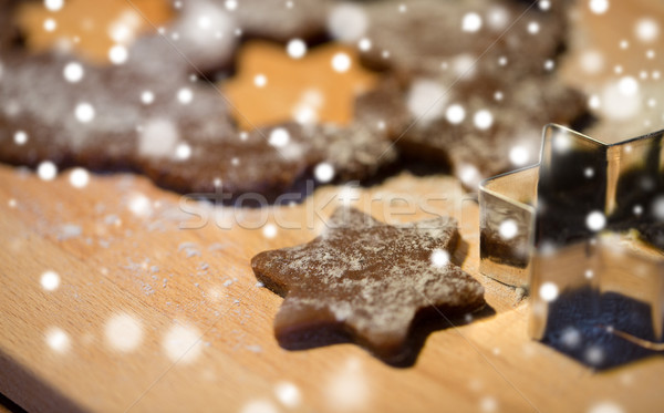 close up of ginger dough, molds and flour on board Stock photo © dolgachov