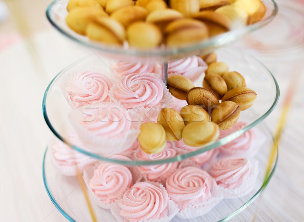 close up of sweets and cookies on serving tray Stock photo © dolgachov