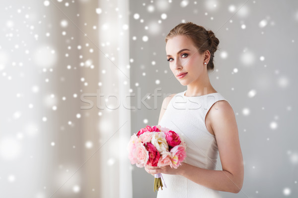 bride or woman in white dress with flower bunch Stock photo © dolgachov