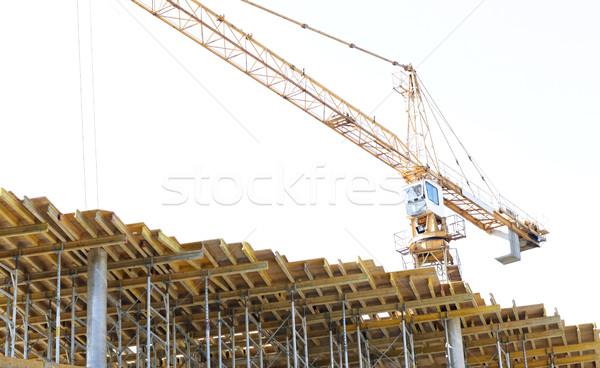 crane at construction site Stock photo © dolgachov