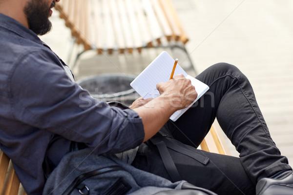 Közelkép férfi ír notebook figyelmeztetés életstílus Stock fotó © dolgachov