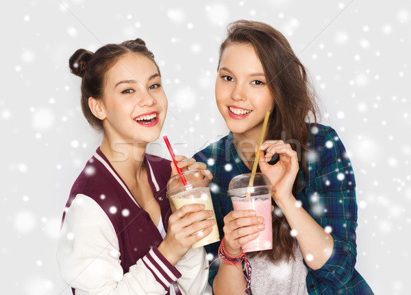 happy pretty teenage girls drinking milk shakes Stock photo © dolgachov