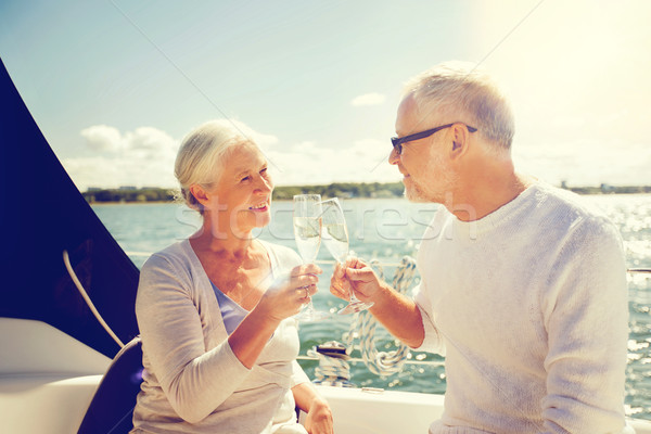senior couple clinking glasses on boat or yacht Stock photo © dolgachov