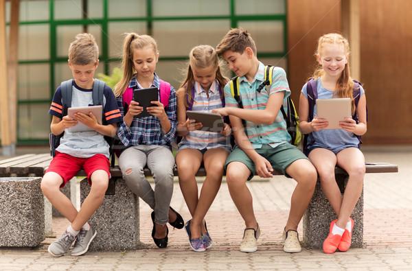 Grupo feliz escuela primaria estudiantes hablar primario Foto stock © dolgachov