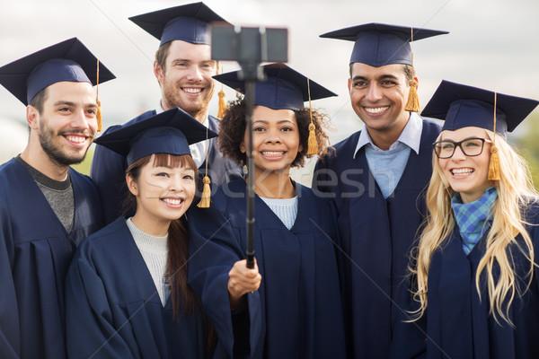 Studenten Junggesellen Aufnahme Smartphone Bildung Abschluss Stock foto © dolgachov