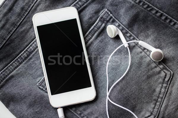 Denim jeans bolsillo tecnología Foto stock © dolgachov