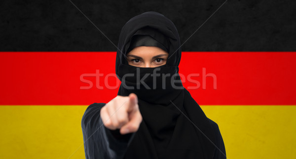 muslim woman in hijab pointing finger to you Stock photo © dolgachov