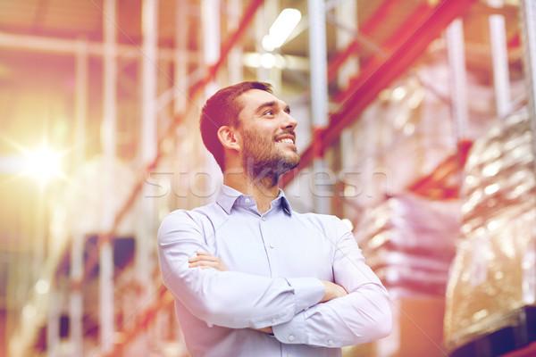 happy man at warehouse Stock photo © dolgachov