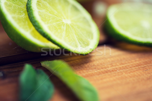 lime slices on wooden table Stock photo © dolgachov