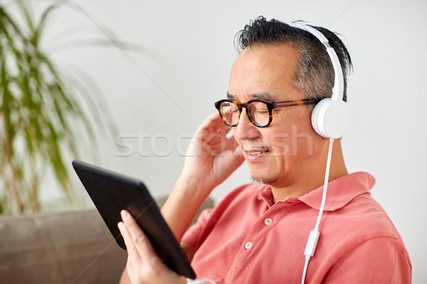 男子 頭戴耳機 家 技術 人 商業照片 © dolgachov
