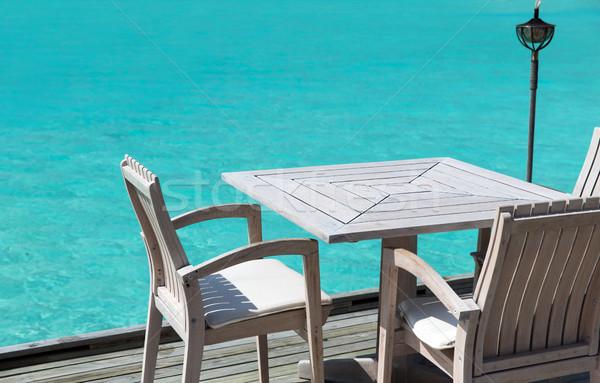 Tabela cadeiras restaurante terraço mar viajar Foto stock © dolgachov