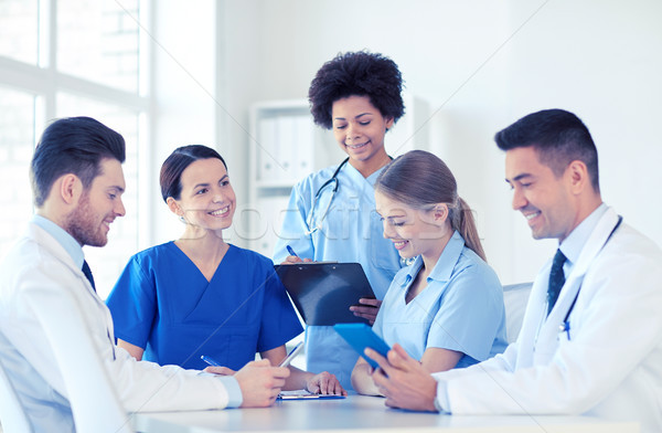 group of happy doctors meeting at hospital office Stock photo © dolgachov